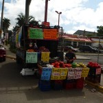 A man sells fruit on the road in Costa Rica in front of one of the country's 50 McDonald's restaurants.