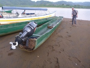 Dug out canoe with Outboard motor in Jaque